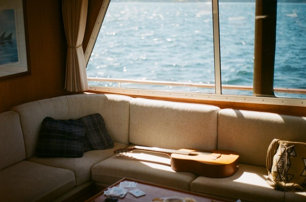 brown and black sofa near window
