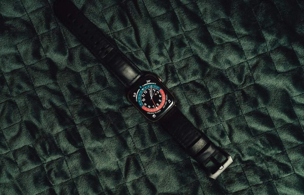 black analog watch at 10 00