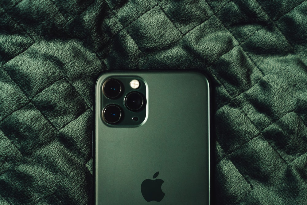 black iphone 4 on green textile