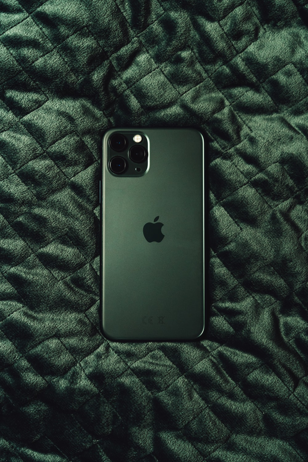 black iphone 7 plus on black and white textile