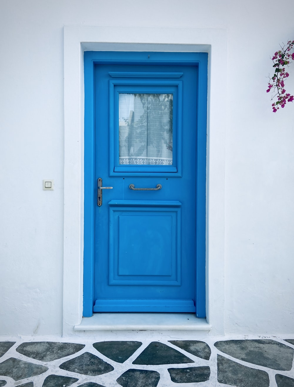blue wooden door with white wooden frame