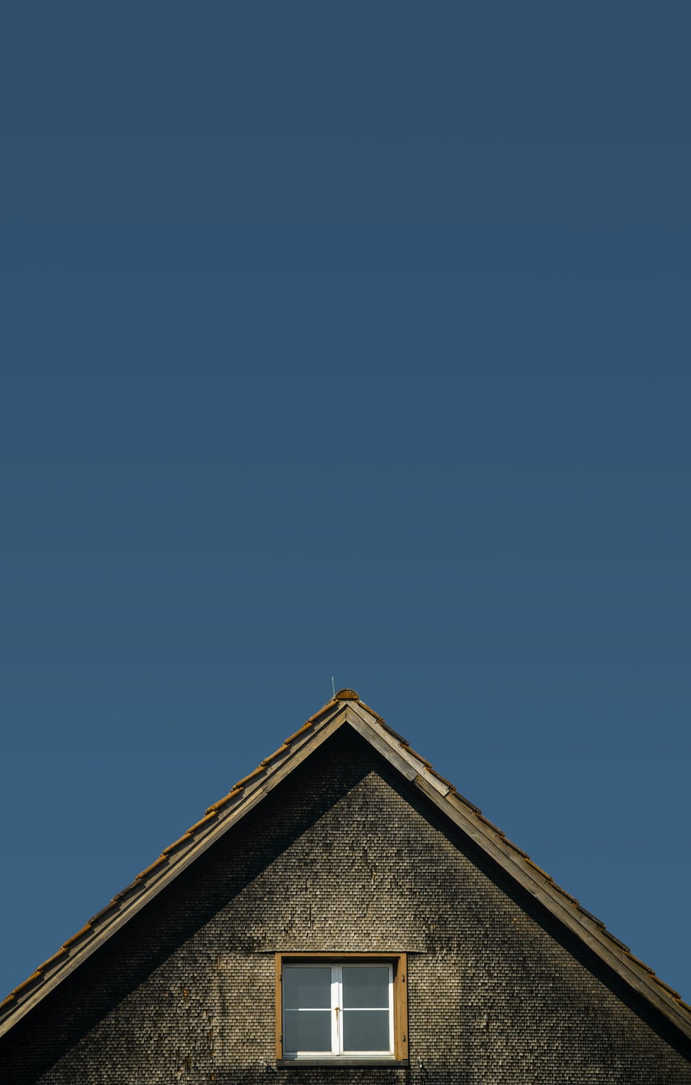 brown and gray house under blue sky during daytime