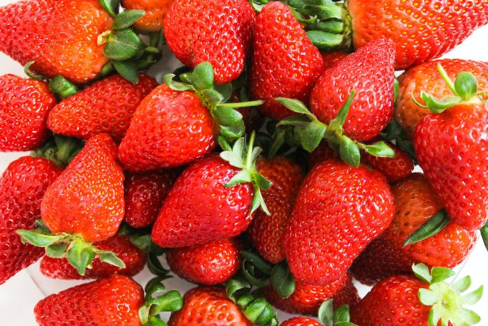 strawberries on black plastic container