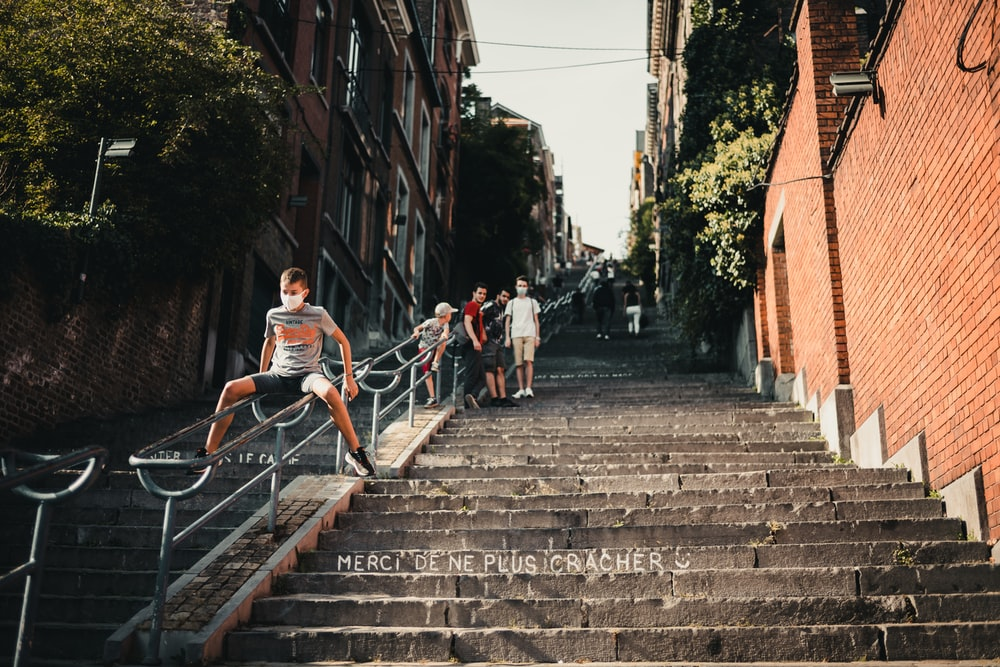 people walking on gray concrete stairs during daytime