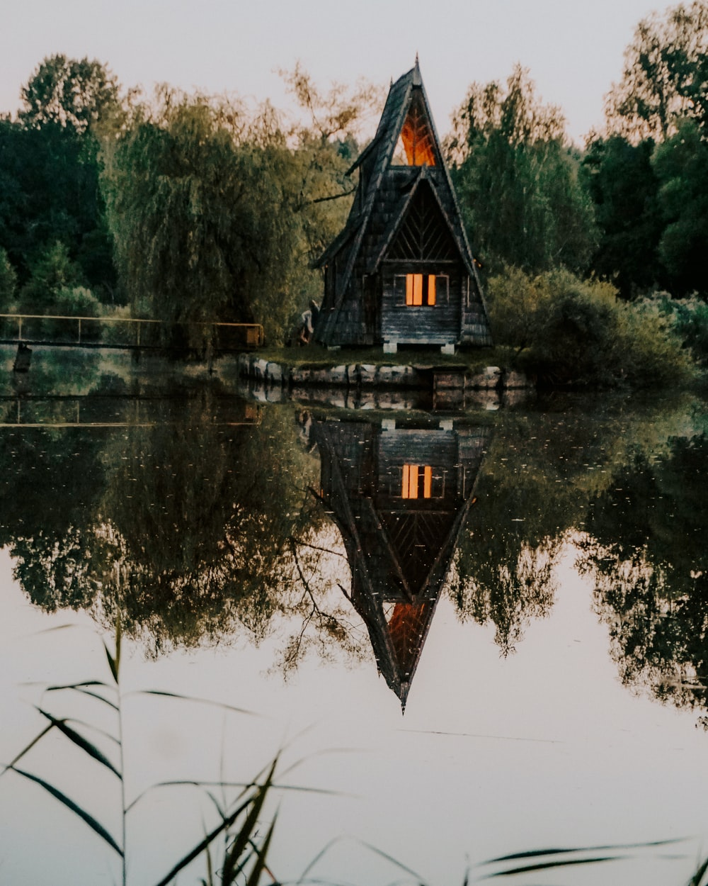 brown and black house on lake during daytime
