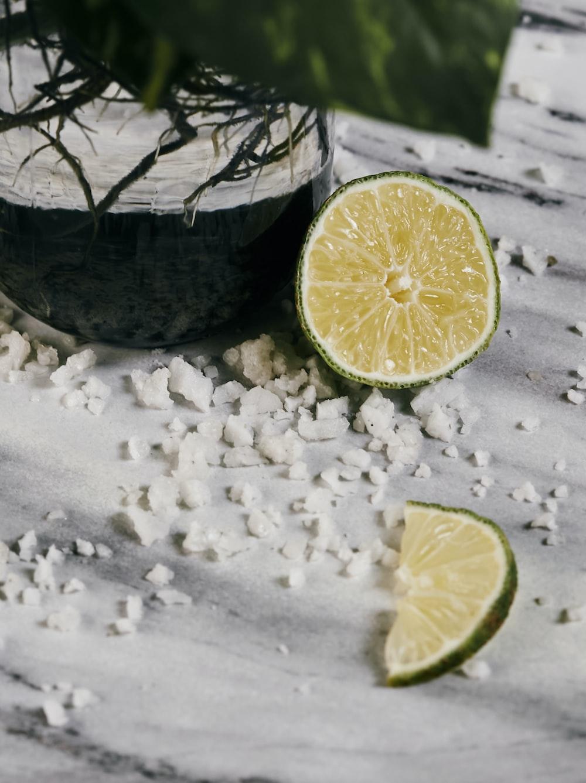 sliced lemon on white snow