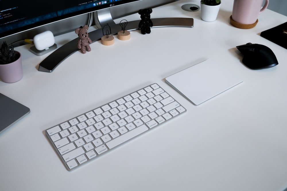silver imac and apple keyboard