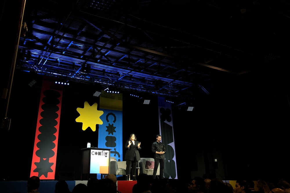 people standing on stage with red yellow and blue star flag