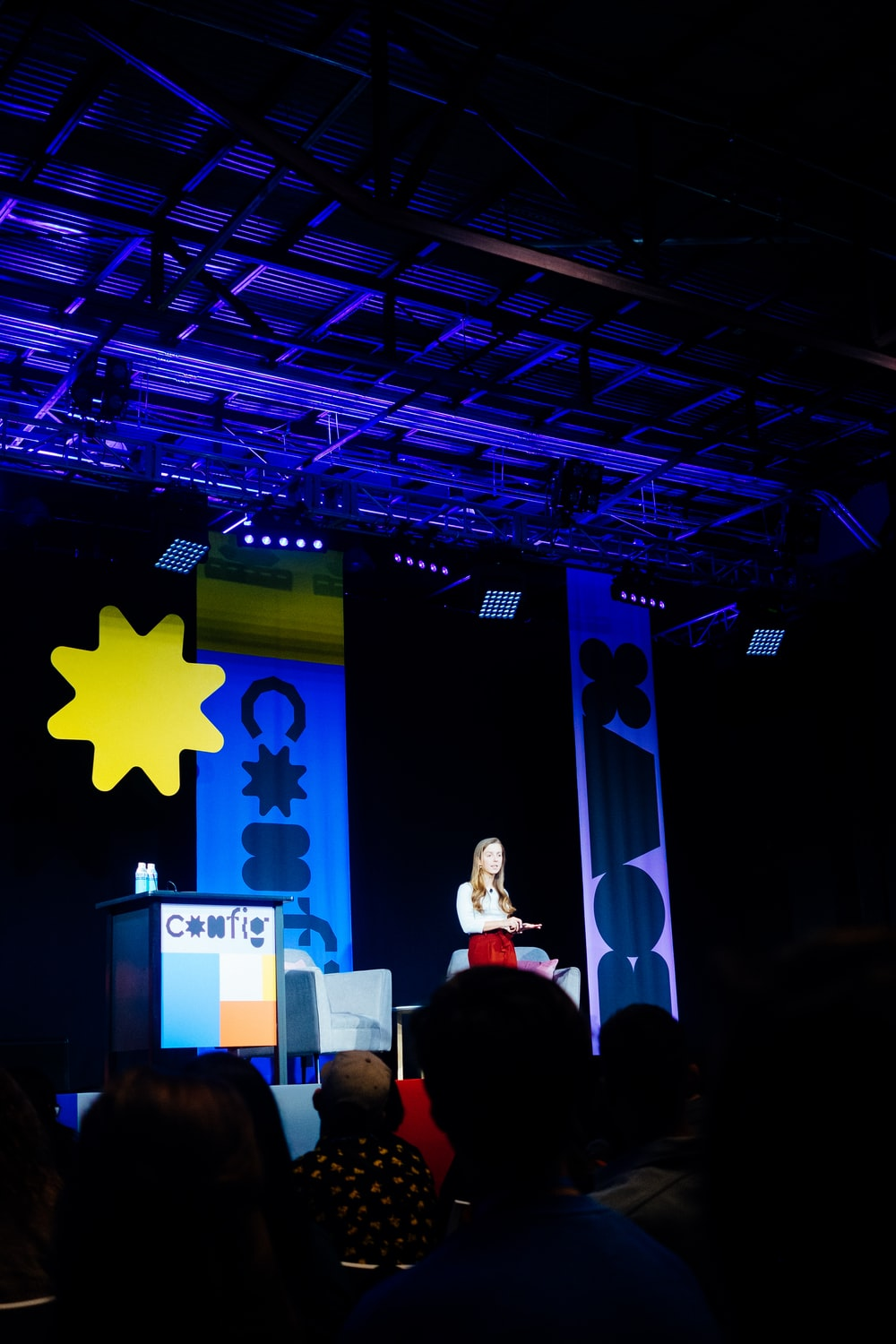 people standing on stage with star on wall