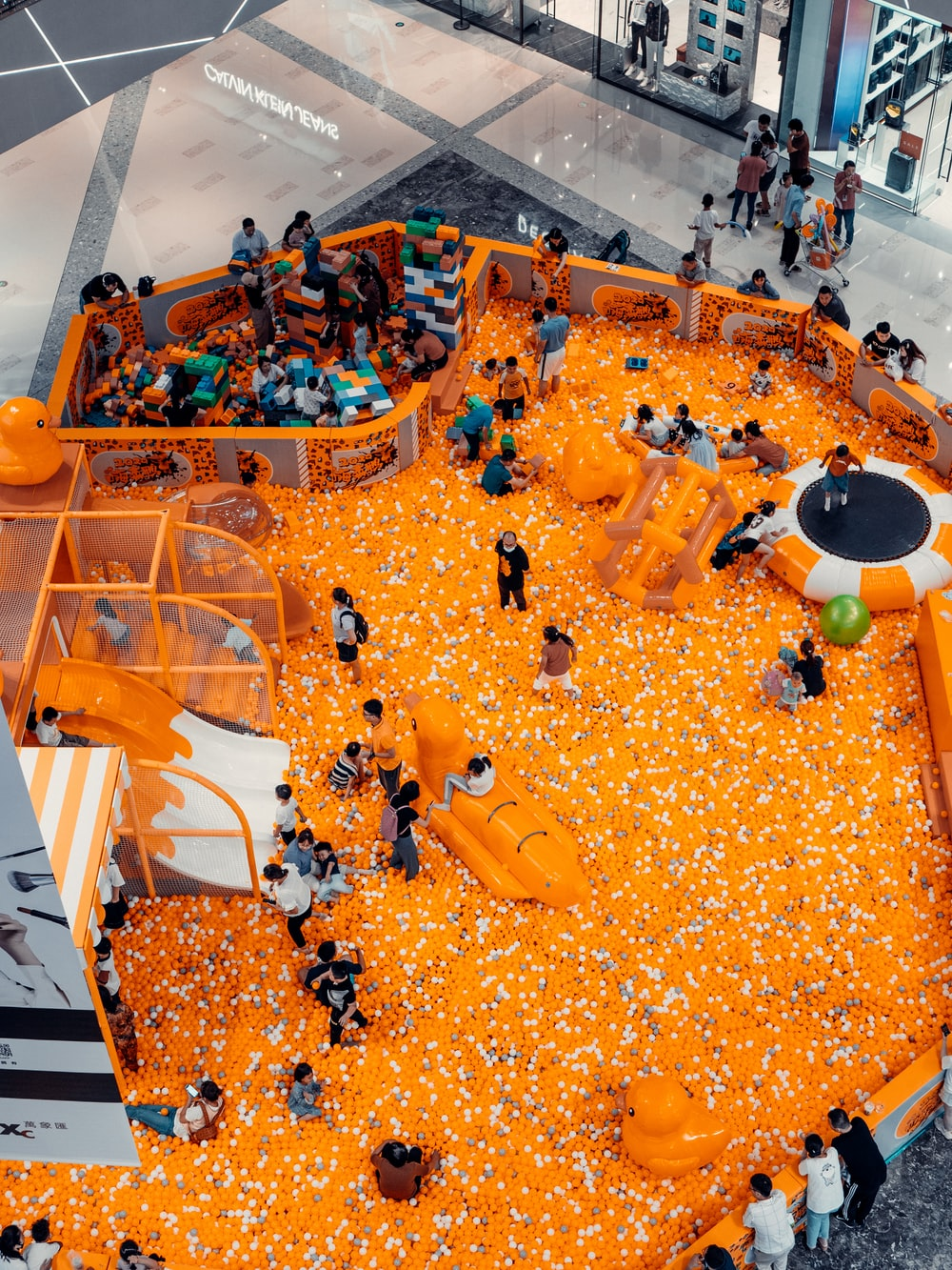 people in white shirt and black pants standing on orange floor