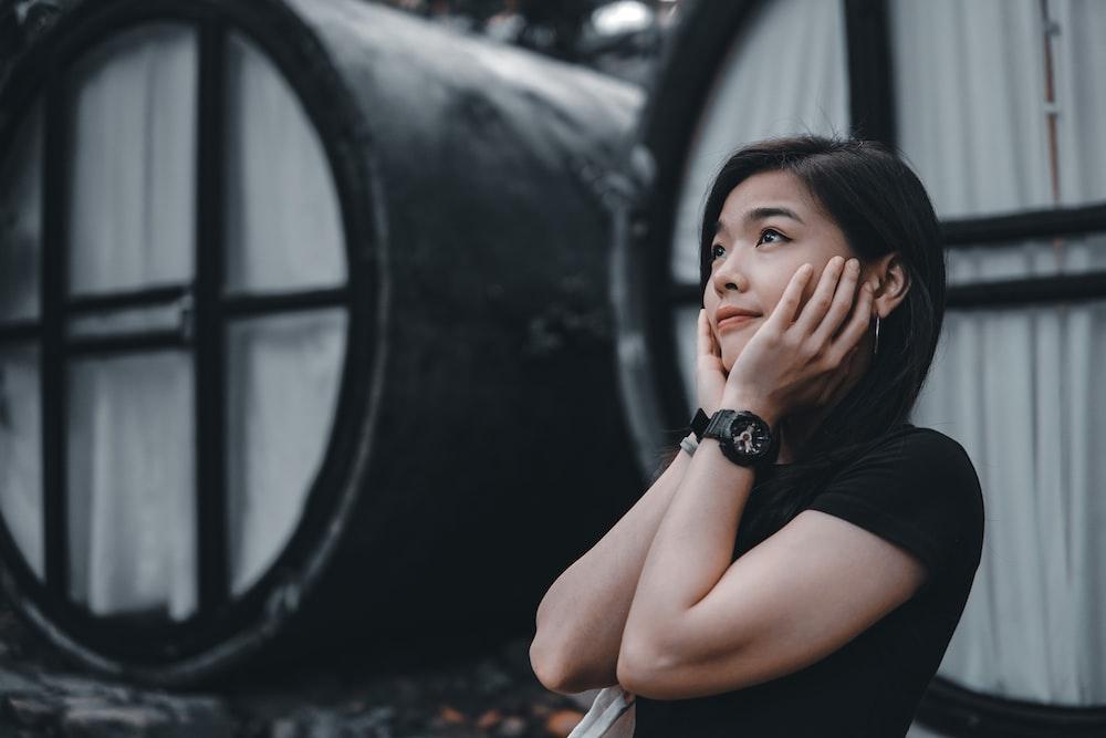 woman in black sleeveless dress wearing black watch