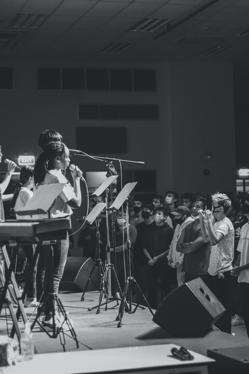 grayscale photo of band performing on stage