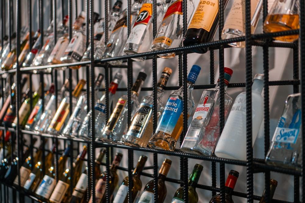 assorted bottles on glass shelf