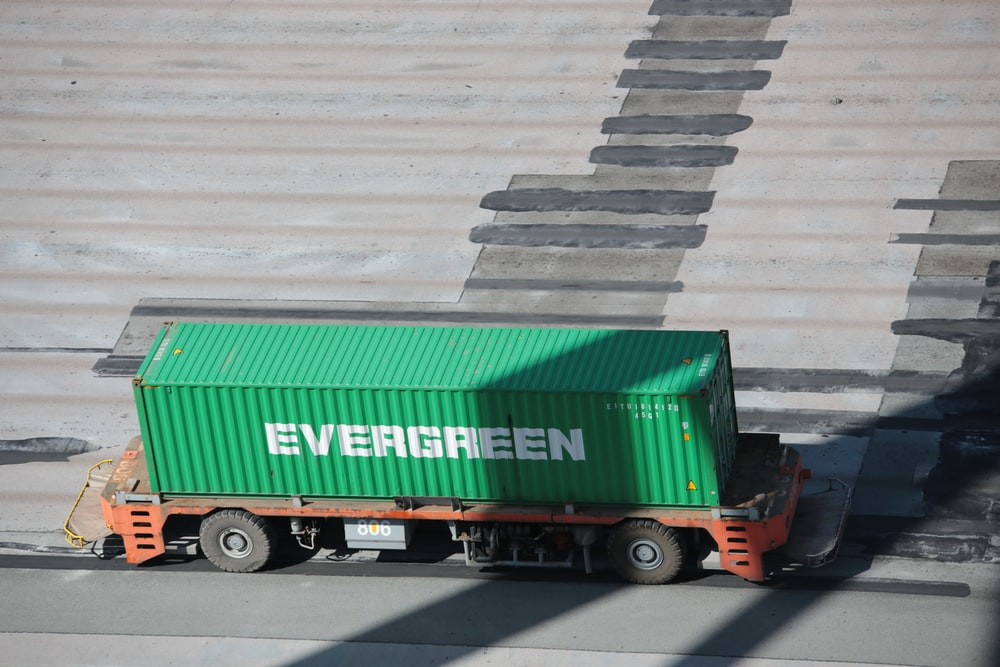 green and red freight truck