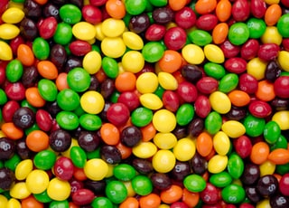 yellow red and green round fruits