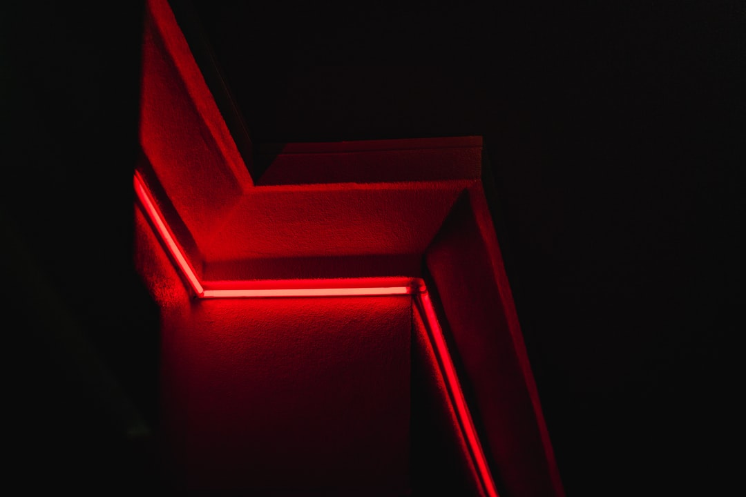 Red Concrete Staircase With Red Light - unsplash