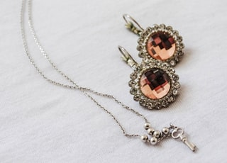 silver and brown gemstone pendant necklace