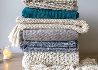 white and blue knit textile