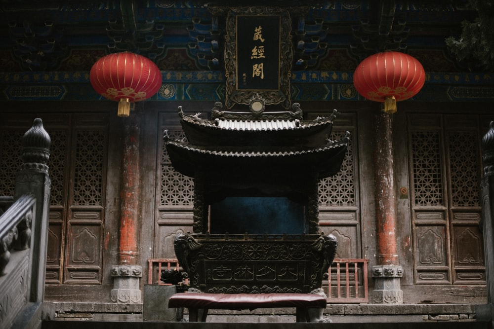 black and brown fireplace with red lantern