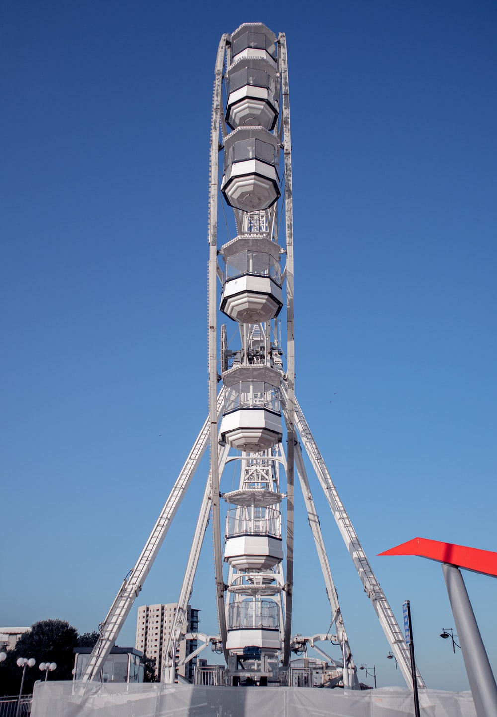 white and red tower under blue sky during daytime