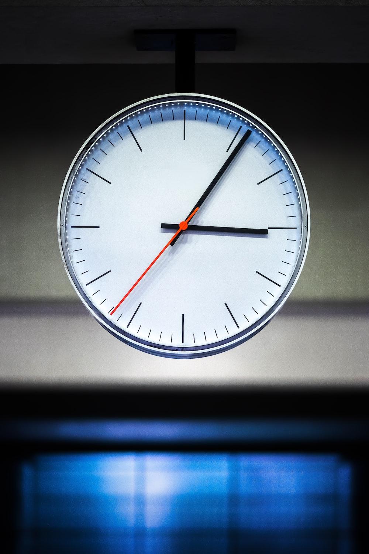 white analog watch at 10