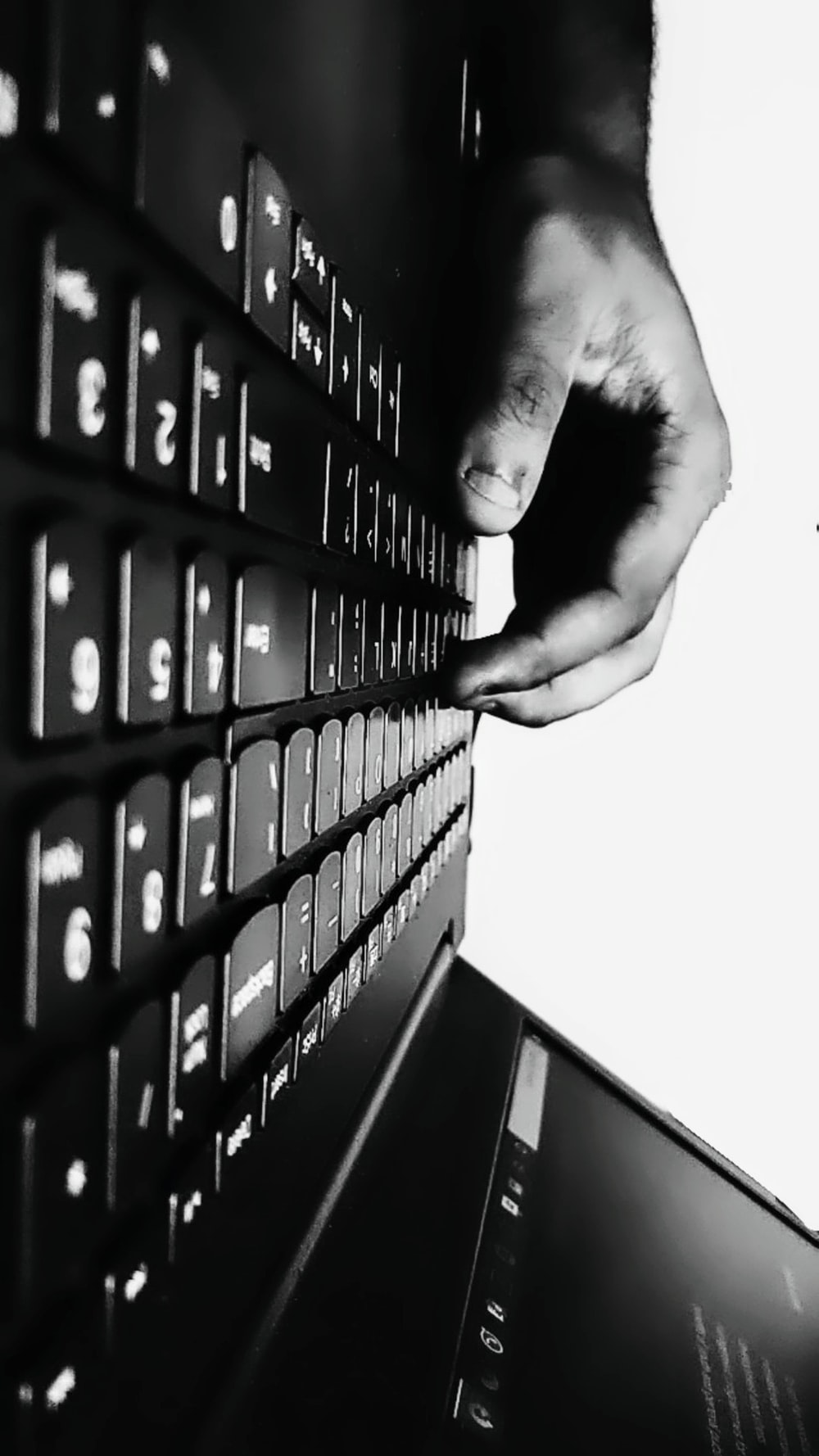 persons hand on black computer keyboard
