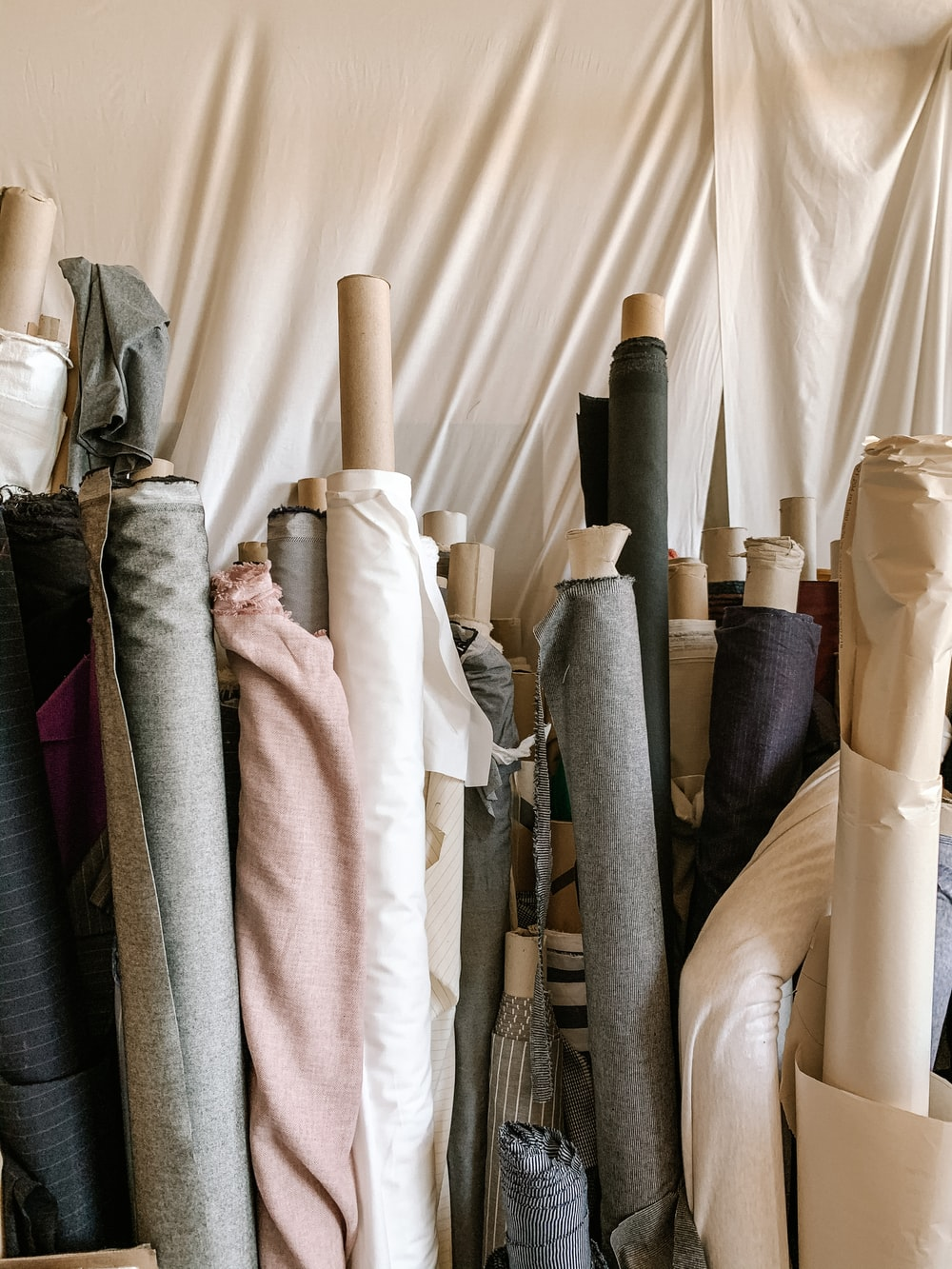white and black textile on white textile
