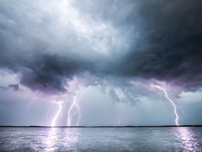 lightning strike on body of water tempest zoom background