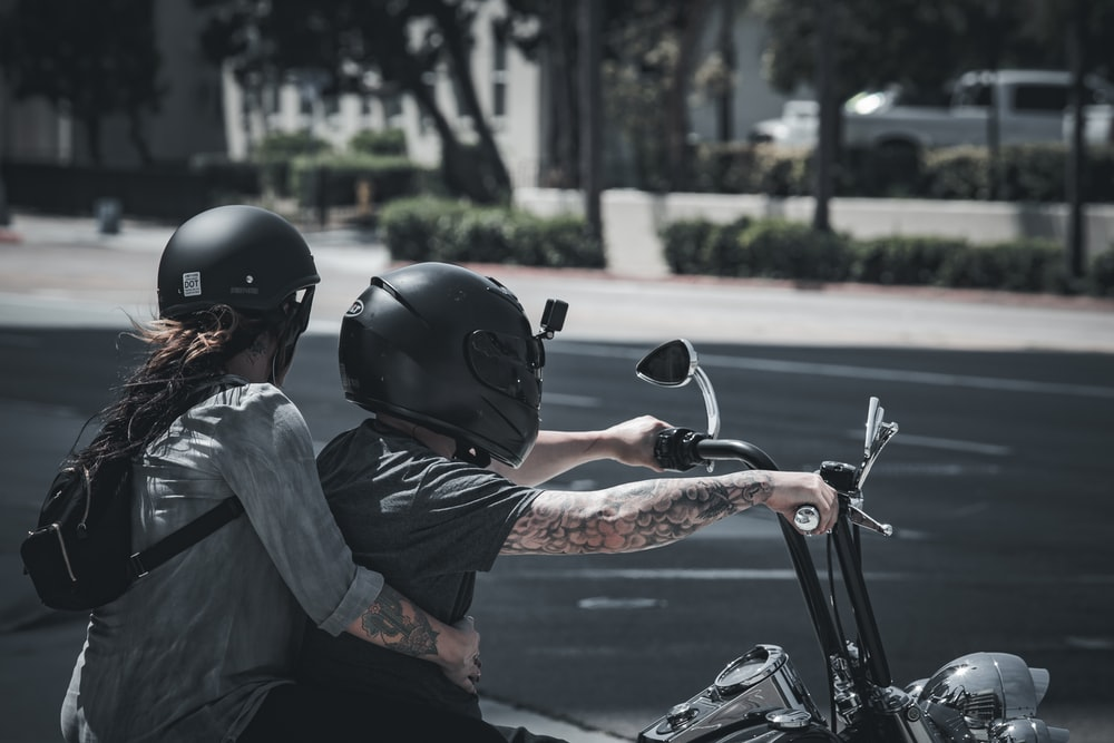 man in black helmet riding on motorcycle during daytime