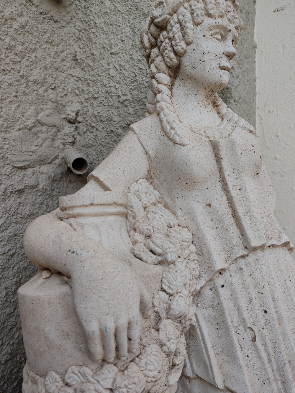white concrete statue on brown sand