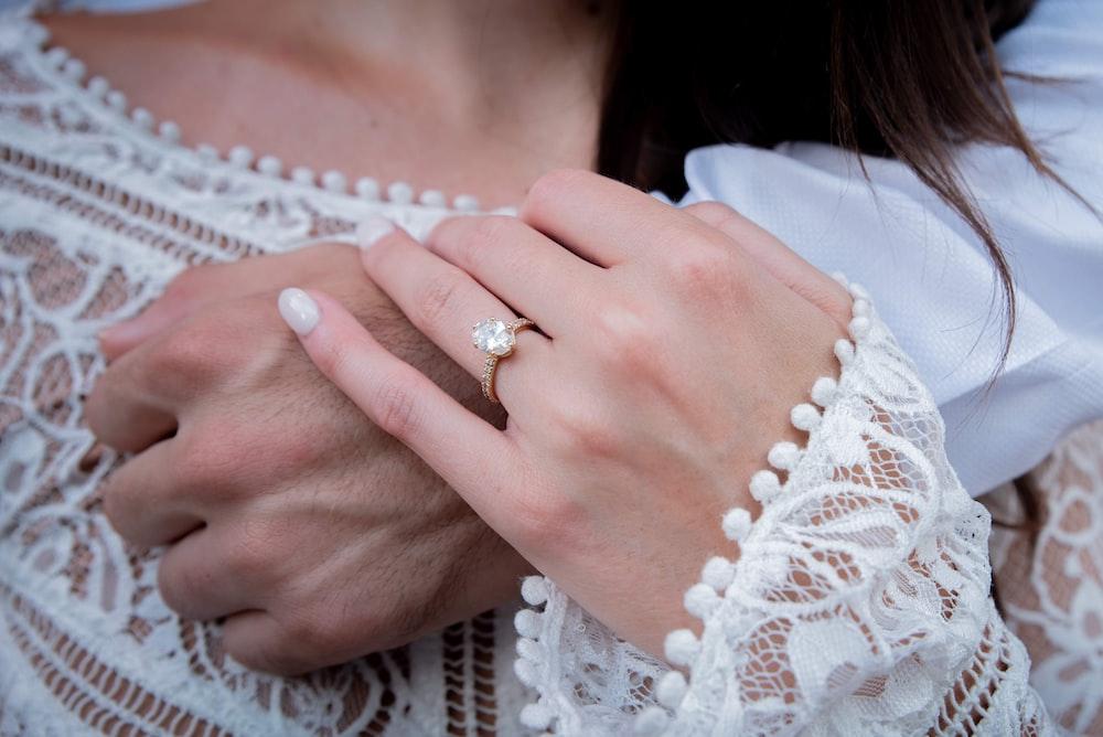 woman wearing gold diamond ring