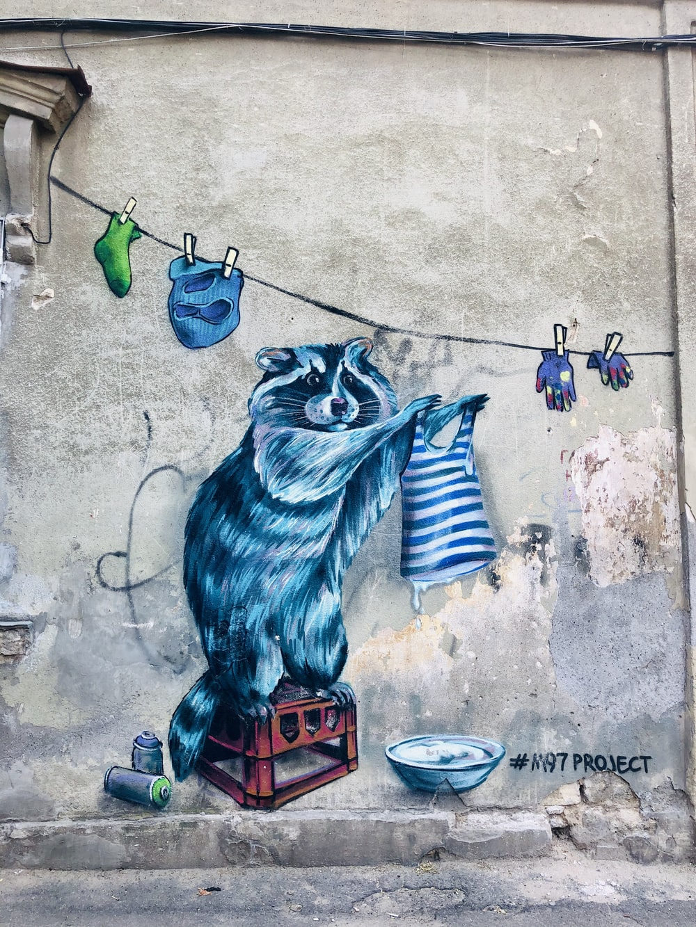 blue lion wall art on gray concrete wall