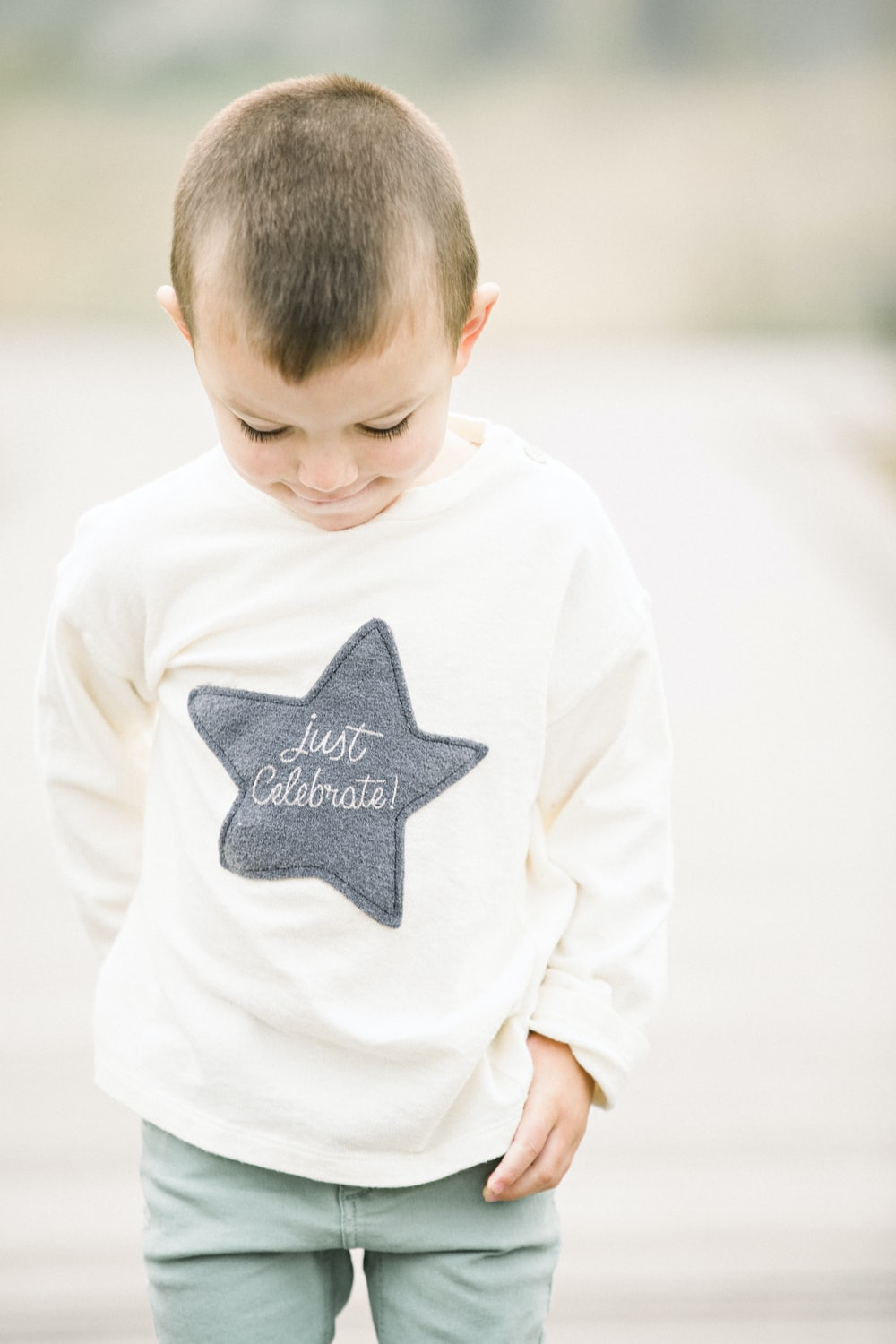 boy in white and gray star printed sweater