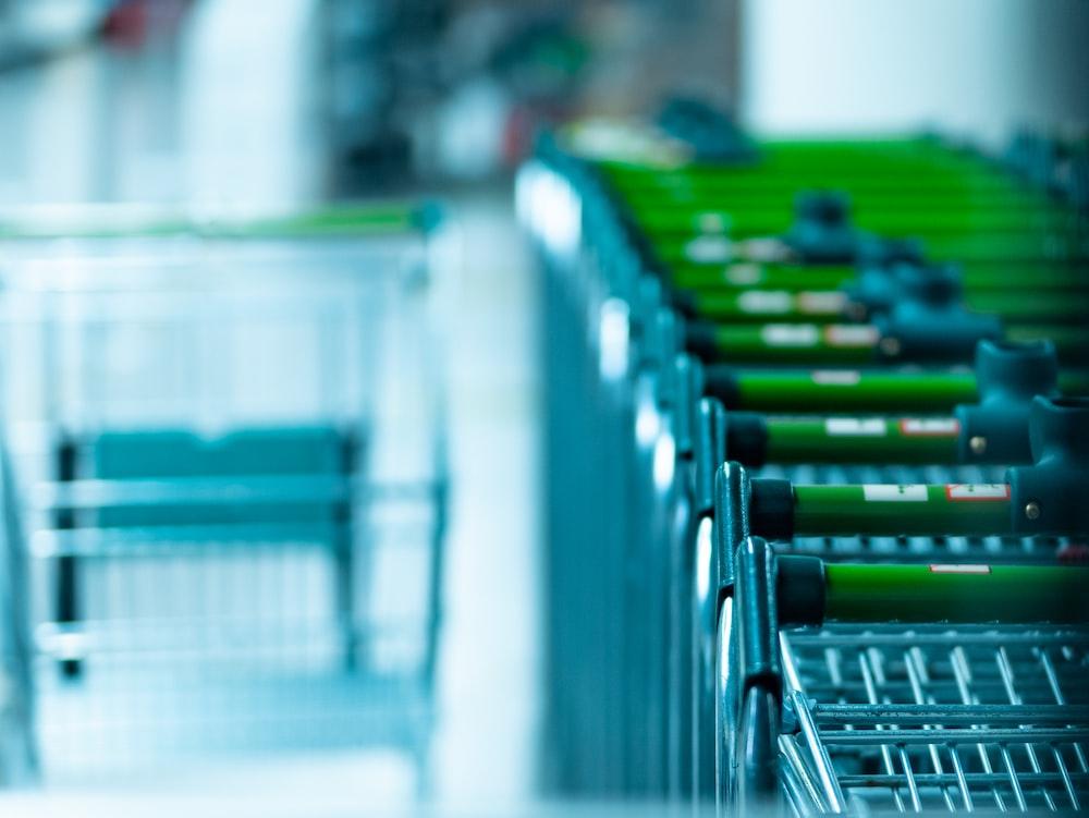 green and gray shopping carts