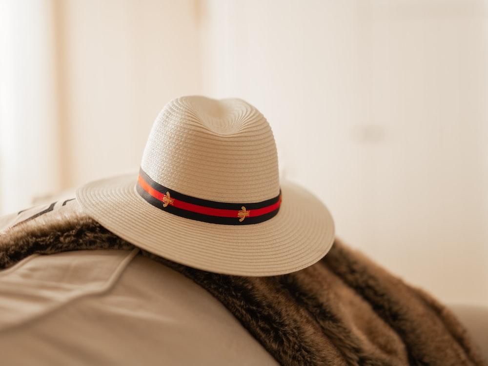 white and black fedora hat