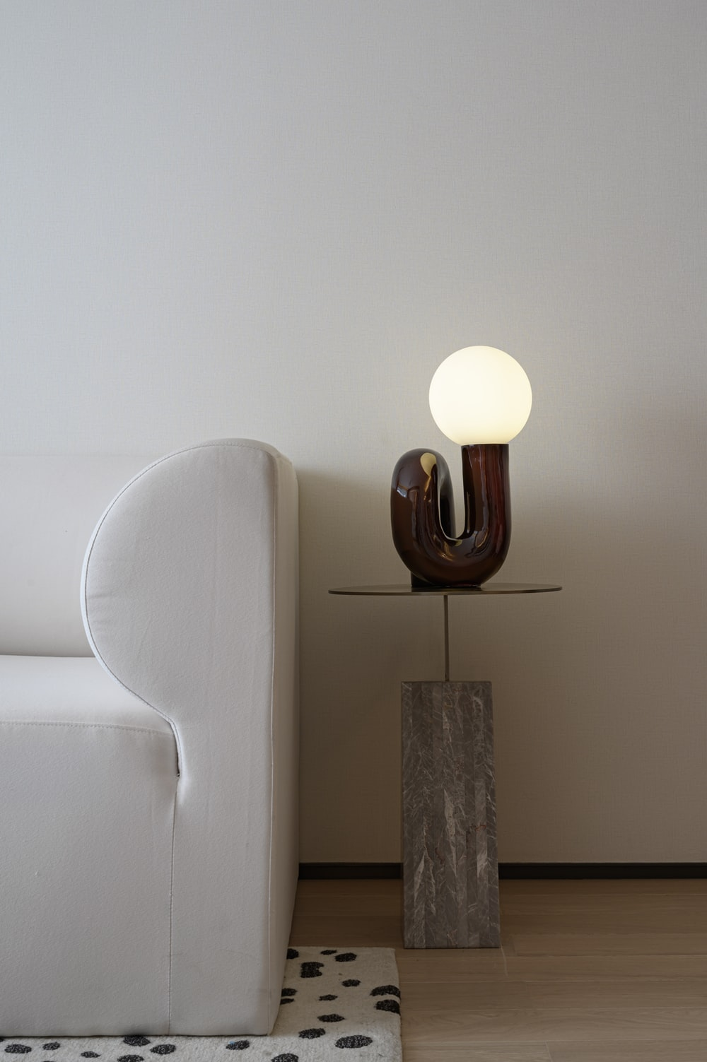 white and brown lamp on brown wooden table