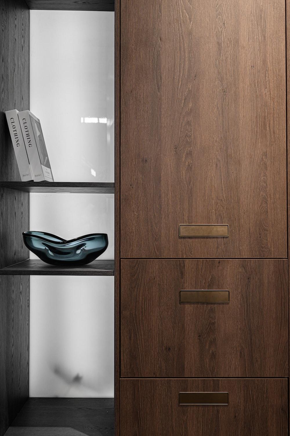 brown wooden cabinet beside white printer