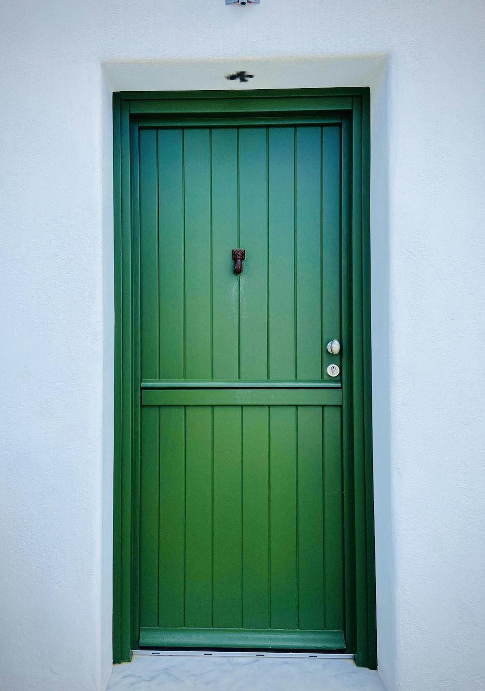 blue wooden door with red door knob