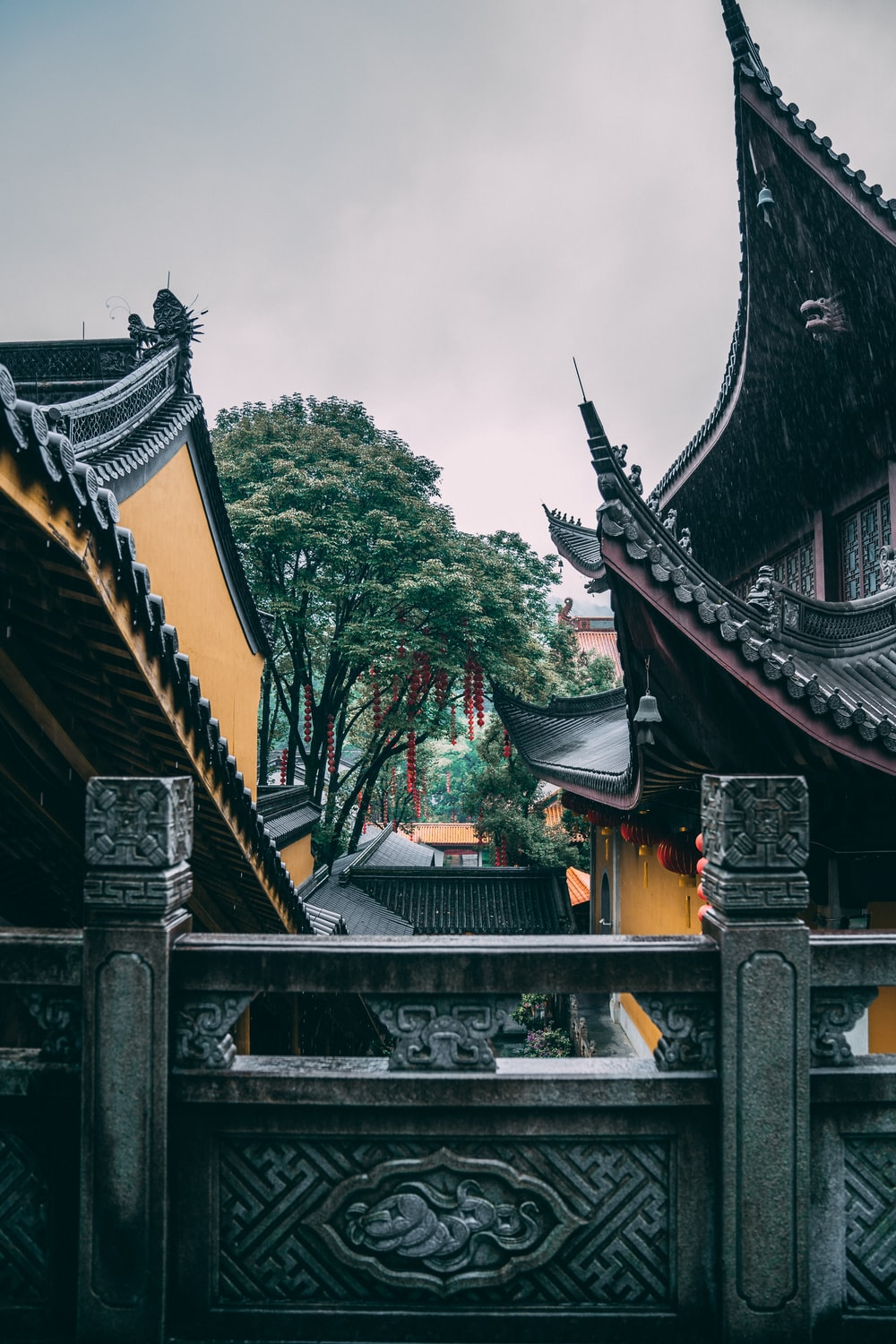 brown and black temple near green trees during daytime