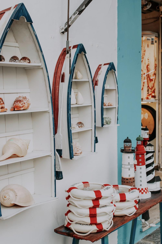 white and blue ceramic plates on white wooden shelf