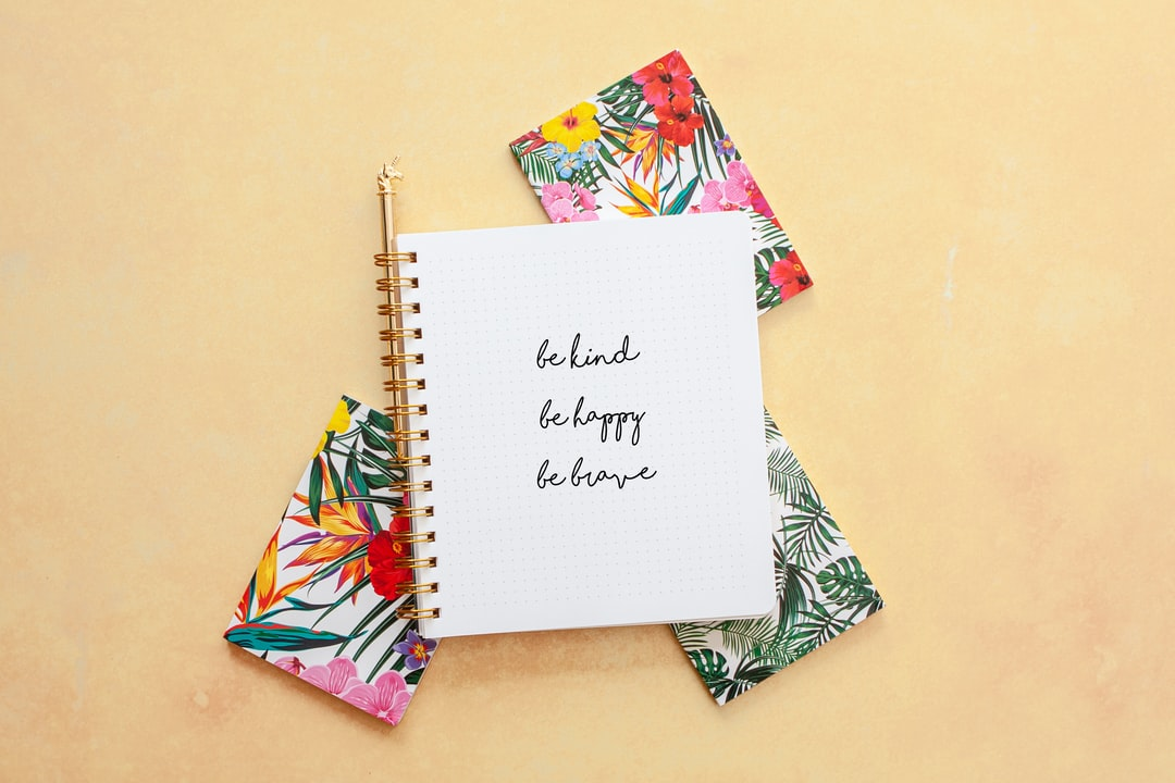 Be Kind, Be Happy, Be Brave. Rainbow Notebooks On Yellow Background - unsplash