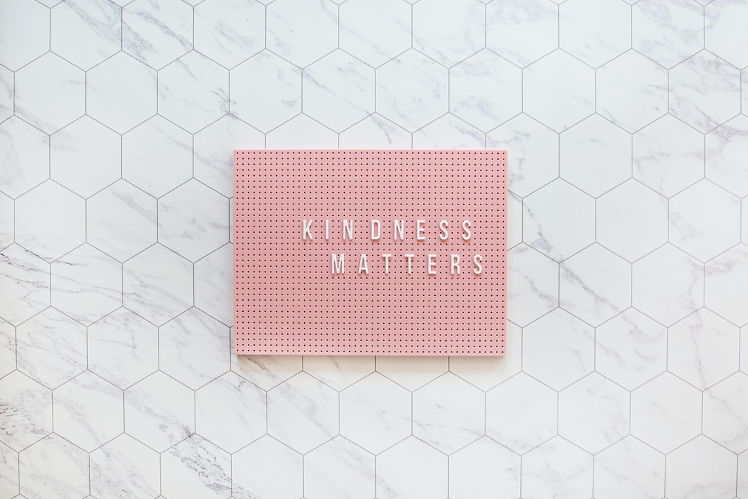 Kindness Matters, Be Kind Always. Pink Pegboard On While Tiles - unsplash