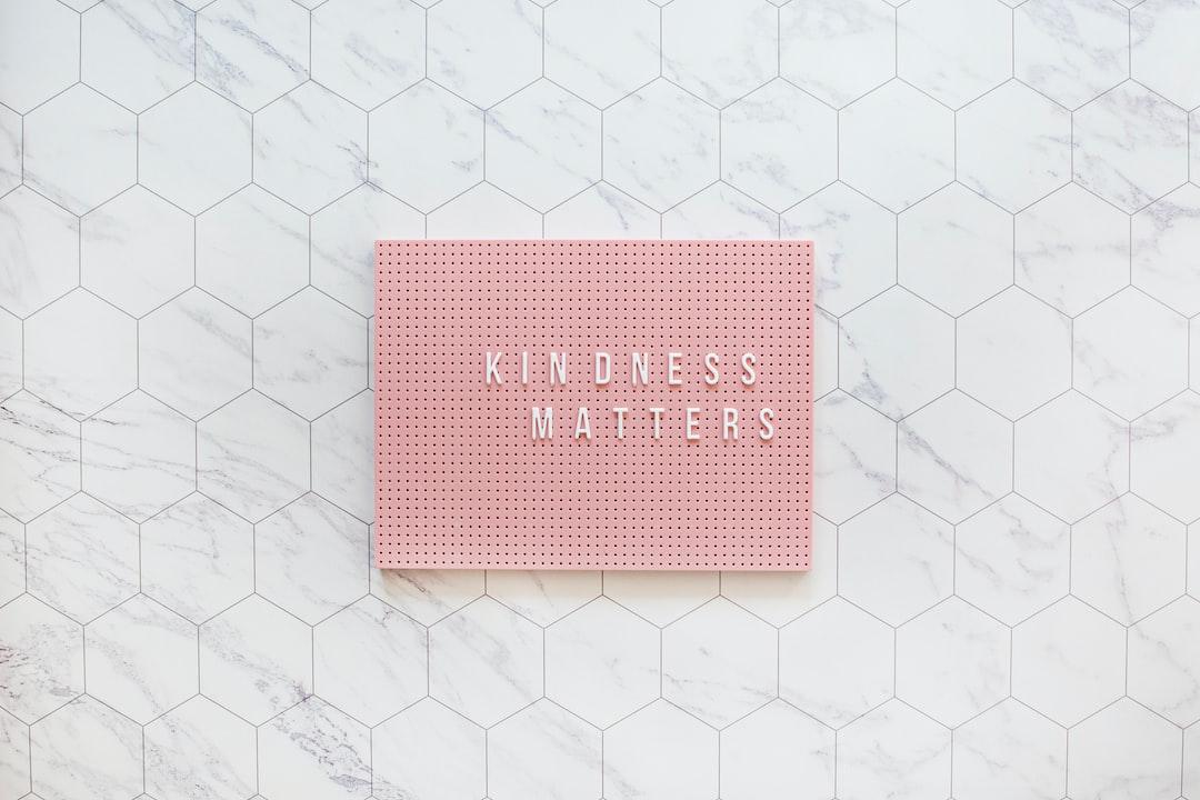 Kindness Matters, Be Kind Always. Pink Pegboard On While Tiles - unsplash