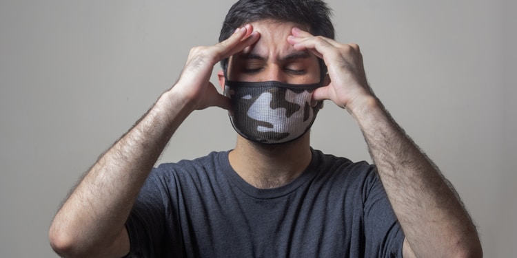 man in black crew neck t-shirt wearing black and white mask