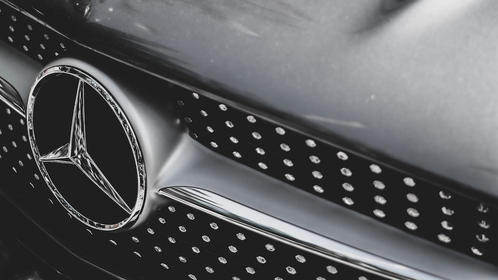 black car steering wheel with water droplets