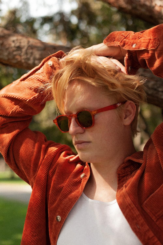 woman in red jacket wearing black sunglasses
