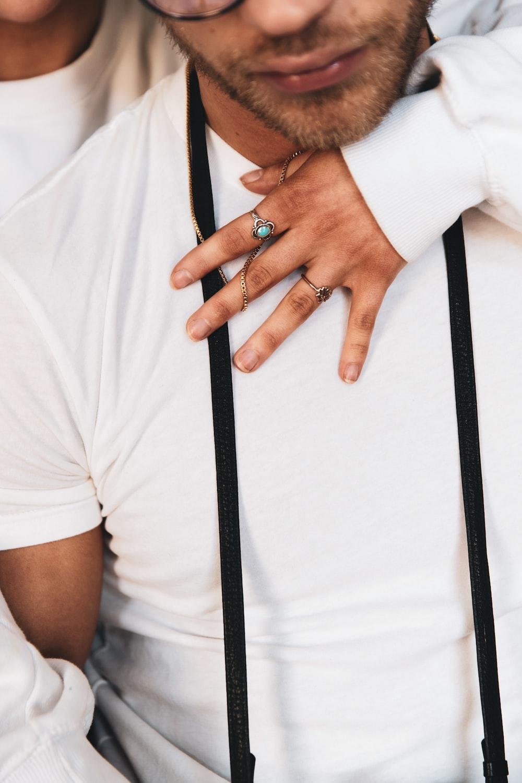 man in white polo shirt