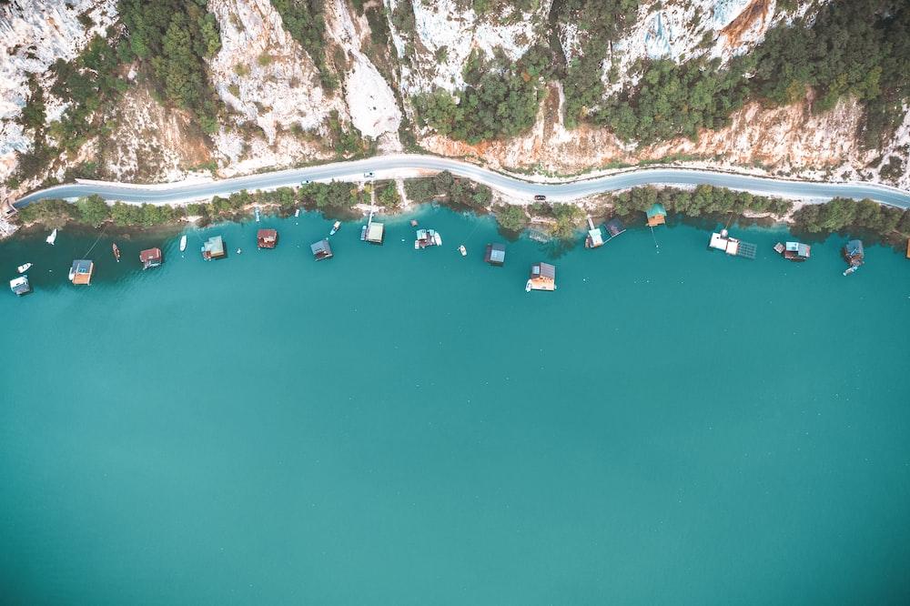 people swimming on lake during daytime