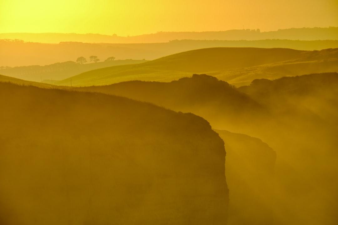 Green Mountains Under White Sky During Daytime - unsplash
