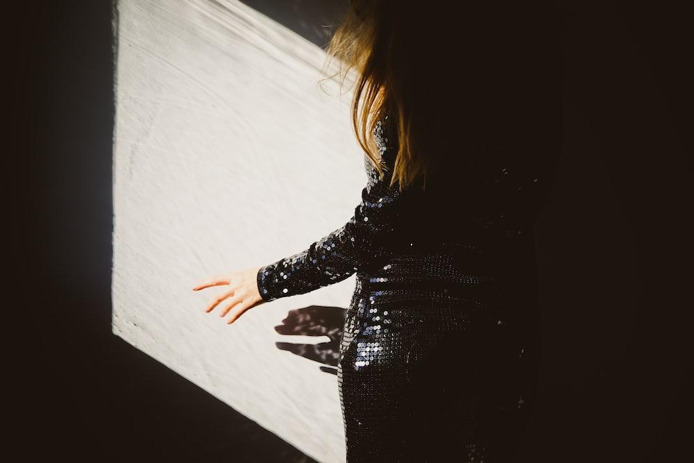 woman in black long sleeve dress